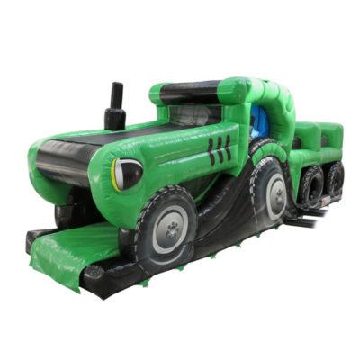 Parcours gonflable en forme de tracteur proposé par Lukylud. Parcours gonflable avec des obstacles de jeu et un toboggan gonflable.