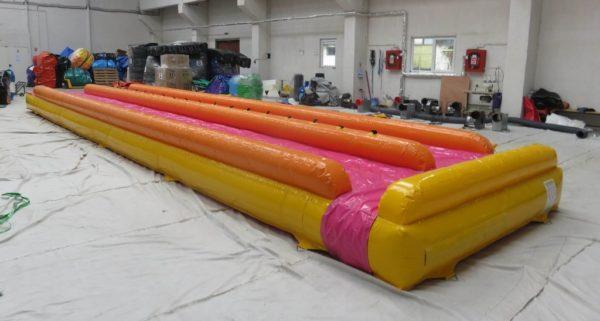 Ventriglisse gonflable double piste avec bâche de glisse en fushia