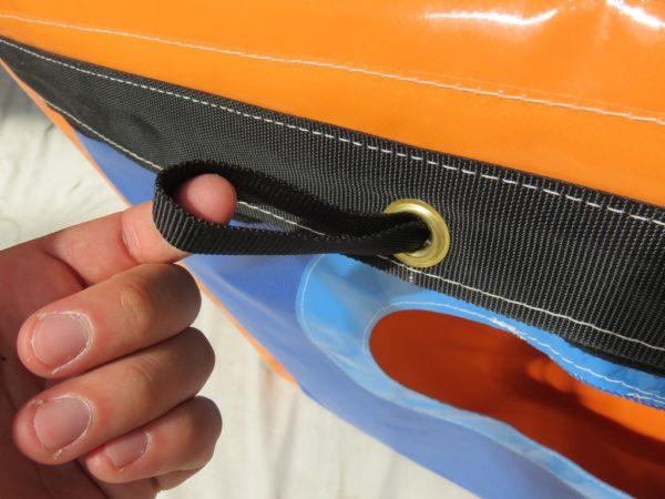 Caisson de protection de soufflerie avec patte d'attache